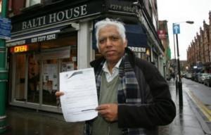 Azmal Hussain outside his restaurant Preem Prithi in Brick lane