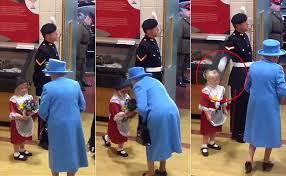 Little girl hit by soldier saluting British queen